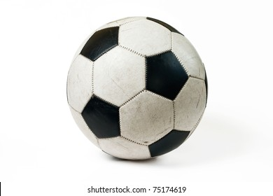 Used classic soccer ball isolated on white background with shadow.