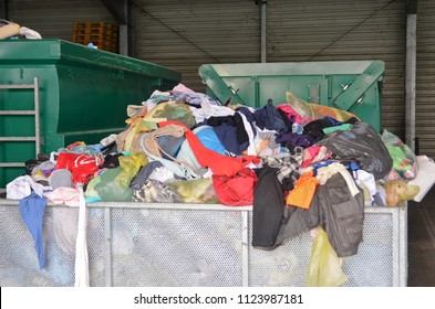 Used clothes at recycling utility. Circular economy concept.