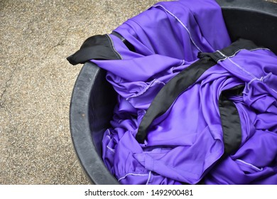 Used cloths in plastic tub, Christian dress for baptism