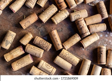 used corks placed on a wooden base
