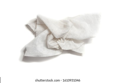 Used and crumpled wet paper towel on a white background. Moisturizing square disposable napkin. Hygiene of the human body.