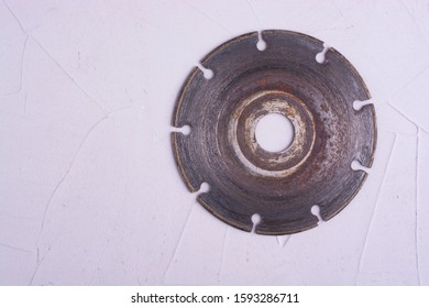 Used diamond blade on concrete floor.