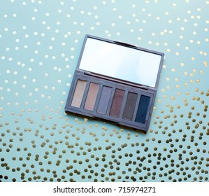 used eyeshadow pallette on polka dot background