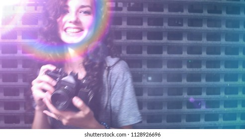 Used film photo shot of happy teenager photographer covered with raindow light leak shot with copyspace