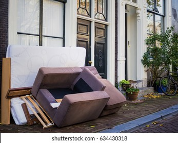 Used furnitures in front of a house