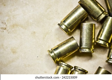 Used Glock 17 bullets shells on stained retro paper texture