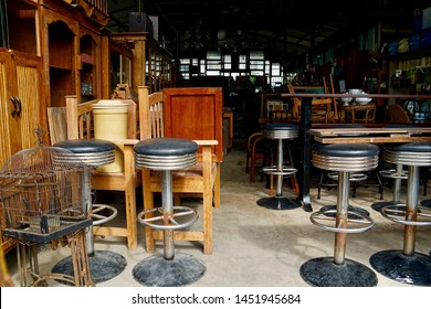 Used high chairs and tables. Second hand street shop. Used bar materails and stuffs for selling such as stairs, lamps, furnitures, chairs, tables and miscellaneous items. Pawn shop front.