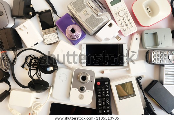 Used modern Electronic gadgets for daily use on White floor, Reuse and Recycle concept, Top view.
