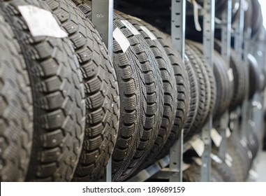 Used old car tires at warehouse.