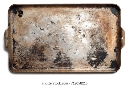 Used Oven Flat Baking Pan with Burned Spots and Scratches.  It's horizontal that can be used vertical and isolated on white with shadows and a flat lay, top above view.