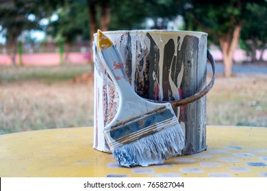 Used Paint brush and old paint bucket.