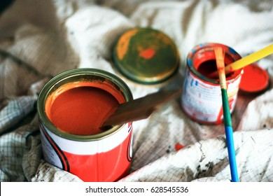 The used paint cans.