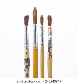 Used paintbrush or dirty paintbrush on white background