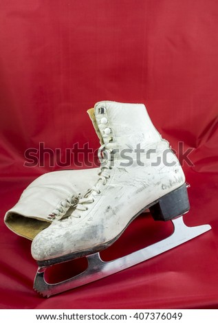81c324f52f4 A used pair of women s white figure skates show their age with scuff marks  on the