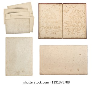 Used paper and old book isolated on white background