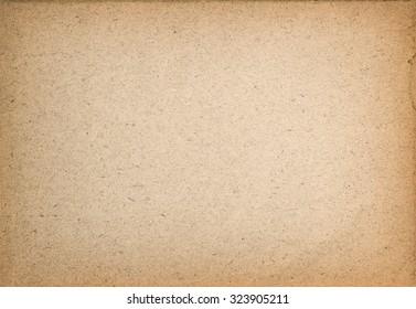Used paper texture. Vintage cardboard background with vignette