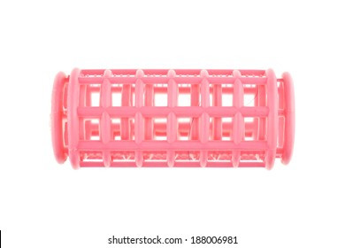 Used pink plastic curler and hair isolated with white background. Beauty and fashion concept photography.