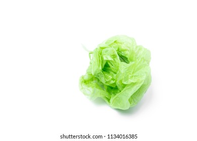 Used plastic bag in green color isolated on white background with copy space