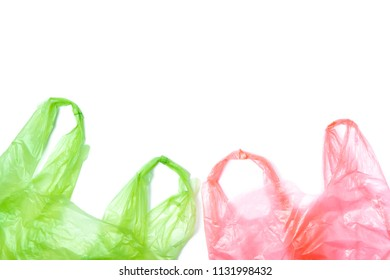 Used plastic bags in green and red color isolated on white background with copy space
