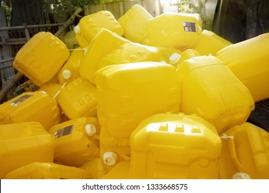Used plastic gallons ready for recycling factory.