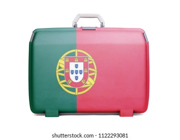 Used plastic suitcase with stains and scratches, printed with flag, Portugal