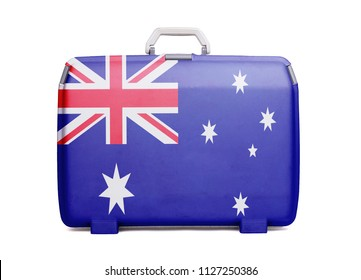 Used plastic suitcase with stains and scratches, printed with flag, Australia