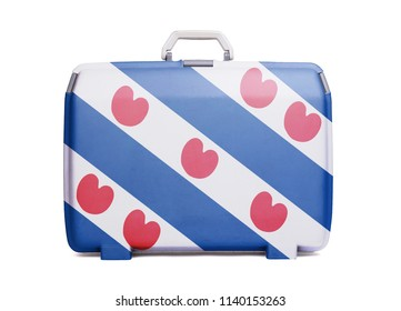 Used plastic suitcase with stains and scratches, printed with flag, Friesland