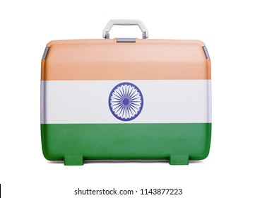 Used plastic suitcase with stains and scratches, printed with flag, India