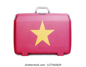 Used plastic suitcase with stains and scratches, printed with flag, Vietnam