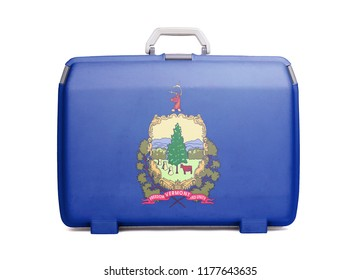 Used plastic suitcase with stains and scratches, printed with flag, Vermont