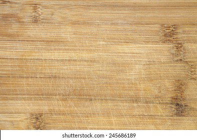 used scratched bamboo wood cutting board background detail