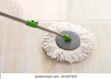 Used  spin mop with microfiber cleaning floor