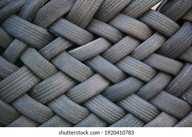 used tires stacked to form an original pattern