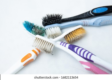 Used toothbrush.Very dirty toothbrush. Plastic waste. Used toothbrushes, reuse, for cleaning