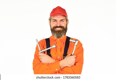 Used to unwind or tighten nuts and bolts. Tools for repair. Happy man worker. Knowing how to change tire is necessary skill for all drivers. Ratchets and sockets in hand tools. Home improvement.