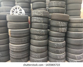 Used wheels of stacked cars