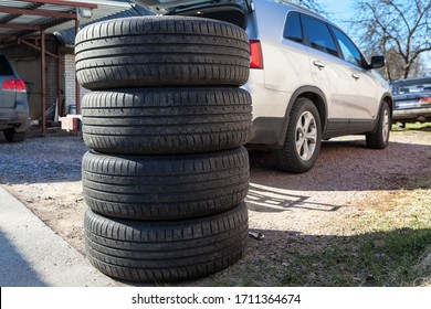 Used wheels with summer tires for suv car stacking on earth, seasonal tyre change