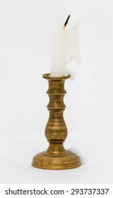 Used white candle on candlestick