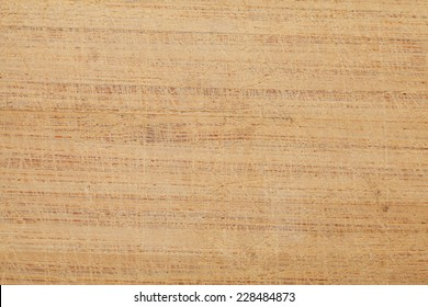 used wooden chopping board surface background with multiple scratches and knife marks