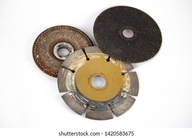 used worn out cut off wheels diamond and grinding wheels and cutting abrasive disc safety work isolated in white background close up photo