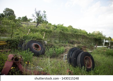 Used and worn tires together with other parts, in a truck graveyard, awaiting to be used again or to recycling, Kozani, Greece.