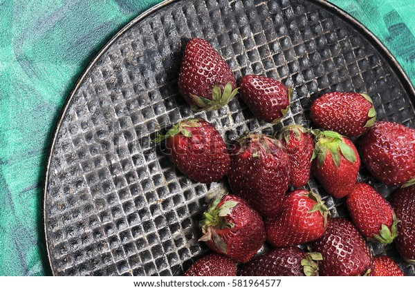 Useful, delicious, juicy strawberries closeup. The view from the top. Proper healthy eating