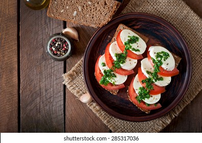 Useful dietary sandwiches with mozzarella, tomatoes and rye bread. Top view