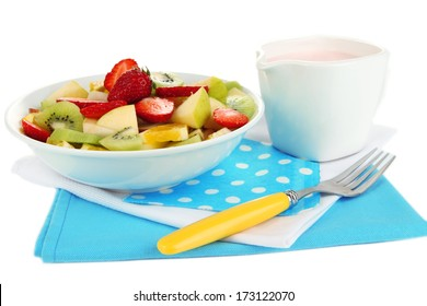 Useful fruit salad of fresh fruits and berries in bowl isolated on white