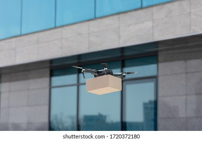 Useful gadget. Drone fast delivering medicines in cardboard box to sick people in the city, contactless delivery
