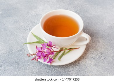 Useful herbal tea from fermented leaves fireweed on grey background. Traditional Russian Koporye Tea Ivan Chai Copy space