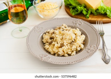 Useful mushroom risotto on a white background.
