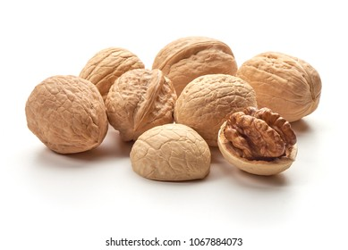 Useful walnuts, close-up, isolated on white background.