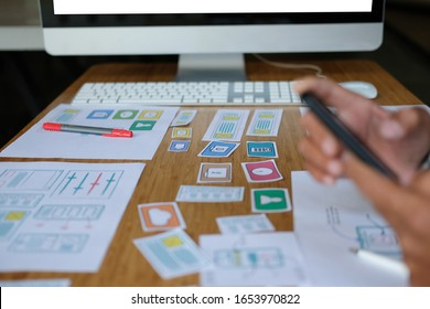 user experience UX designer designing web on smart phone layout. UI planning mobile application. developer work with business prototype