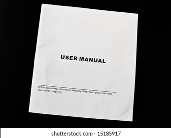 User manual guide brochure against the black background